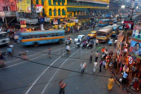 Photo for Street traffic blurred in motion at evening n Kolkata, India. Kolkata has a density of 814.80 vehicles per km road length - Royalty Free Image