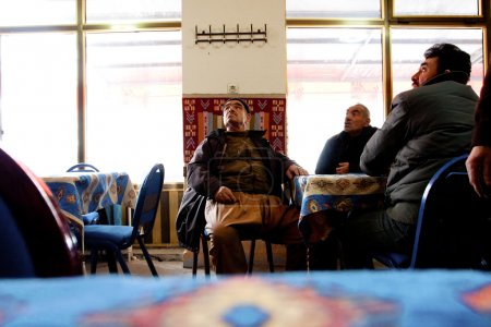 Seniors talk in a traditional tea house in Middle East