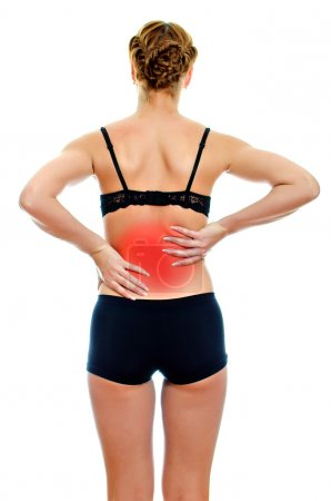 Rear view of young woman with spinal pain. Isolated on white