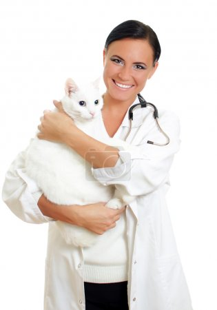 Veterinarian with a cat in her arms. Isolated on white.