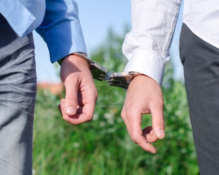Two FBI agents conduct arrest of an offender