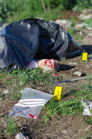 Crime scene with male corpse and evidence markers