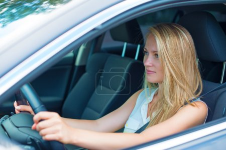 Photo for Beautiful young woman driving a car. - Royalty Free Image