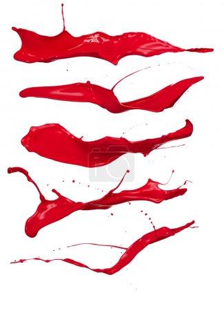 Photo pour Prise de vue des éclaboussures de peinture rouge, isolé sur fond blanc - image libre de droit