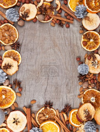 Photo for Christmas spices with dry orange and apple slices in frame with free space for text - Royalty Free Image