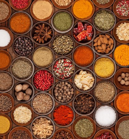Photo for Various kinds of spices on wooden table - Royalty Free Image