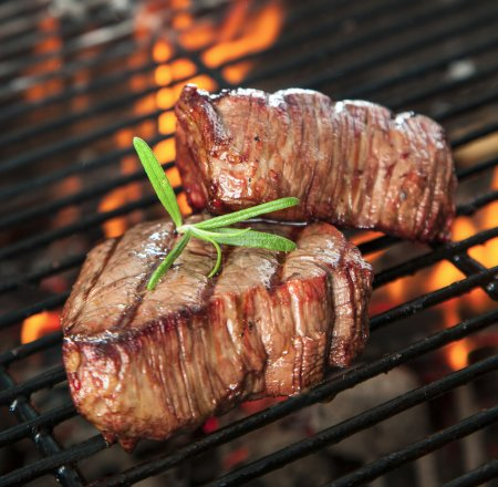 Photo for Delicious beef steakes on grill - Royalty Free Image