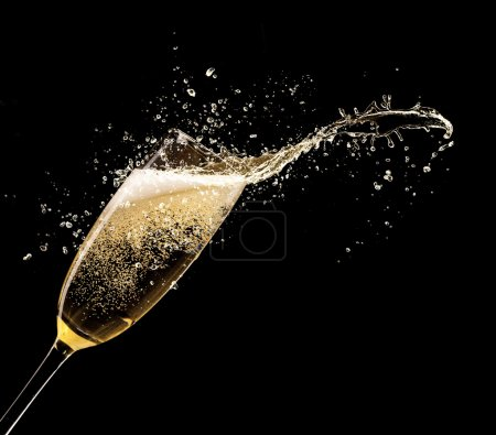 Photo for Glass of champagne with splash, isolated on black background - Royalty Free Image