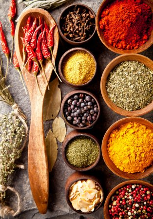 Photo for Various spices in wooden bowls - Royalty Free Image