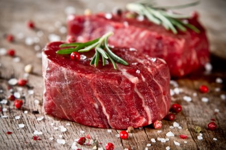 Photo for Fresh raw beef steak on wood - Royalty Free Image