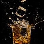 Постер, плакат: Splashing whiskey