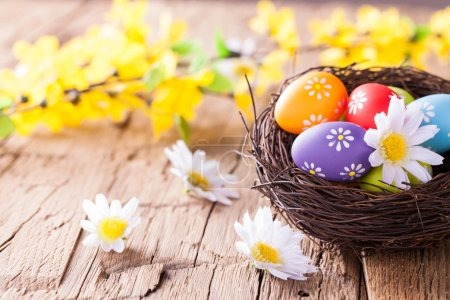 Photo for Easter still life with traditional decorative eggs in nest - Royalty Free Image