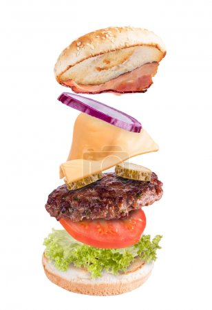 Photo for Flying ingredients in hamburger, isolated on white background - Royalty Free Image