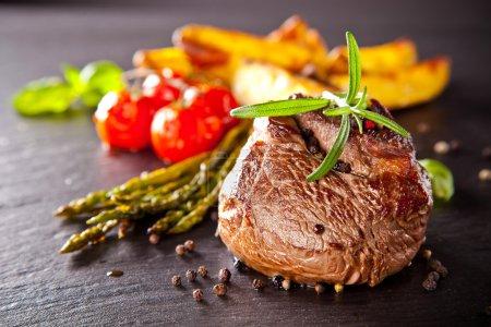 Fresh beef steak on black stone