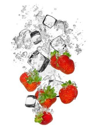 Fresh strawberries falling in water splash