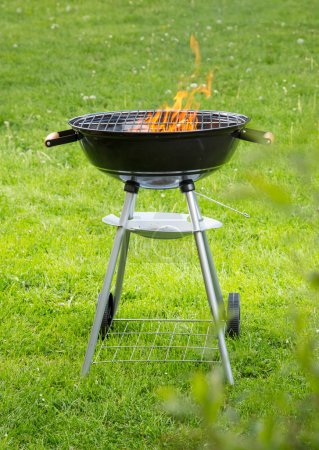 Empty grill on garden
