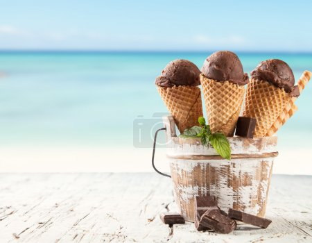 Photo for Fruit ice cream served on wood with beach on background - Royalty Free Image