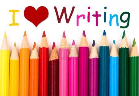 Photo pour I Love Writing, Une bordure de crayon isolé sur fond blanc avec des mots que j'aime écrire - image libre de droit