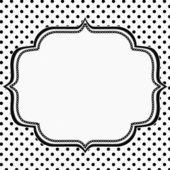 Puntíkované černé a bílé pozadí s výšivkou