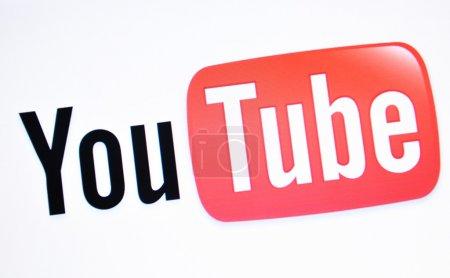 YouTube logo close-up on laptop screen