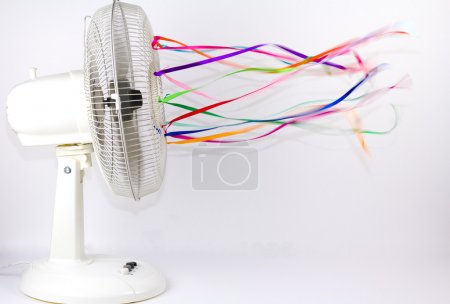 Photo for An electric fan blowing colorful silk ribbons - Royalty Free Image