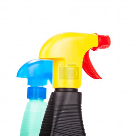 Hand squirting a bottle of cleaning spray