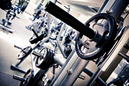 Photo for Diverse equipment and machines at the gym room - Royalty Free Image