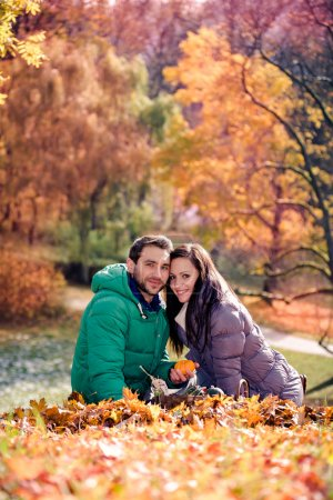 Photo for A young couple in the autumn park - Royalty Free Image