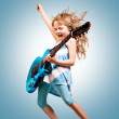 Portrait of young girl with a guitar on the stage...