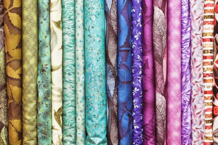 Photo for Rolls of colorful fabric as a vibrant background image - Royalty Free Image