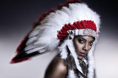 American Indian woman model girl studio portrait wearing war bonnet