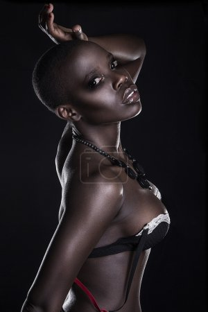 Black African young sexy fashion model studio portrait isolated