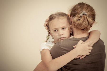 Photo for Sad daughter hugging his mother - Royalty Free Image