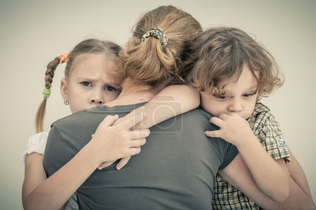 Photo for Sad children hugging his mother - Royalty Free Image