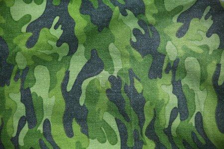 Foto de Patrón de la tela militar como telón de fondo - Imagen libre de derechos