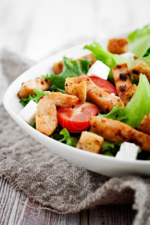 Photo for Salad with roasted chicken, tomatoes and feta - Royalty Free Image