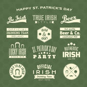 A collection of St Patrick's Day typographic design elements against a green clover seamless background