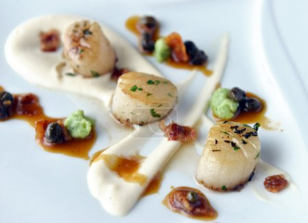 Photo for Scallops with bacon and sauce on a plate - Royalty Free Image