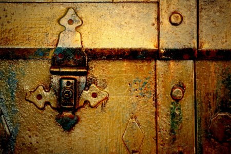 Photo for Old metal chest, trunk in golden color and rusty - Royalty Free Image