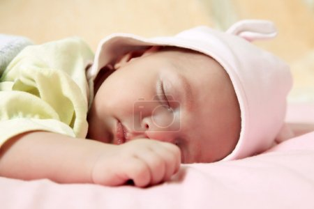 Photo for New born baby girl peacefully sleeping - Royalty Free Image