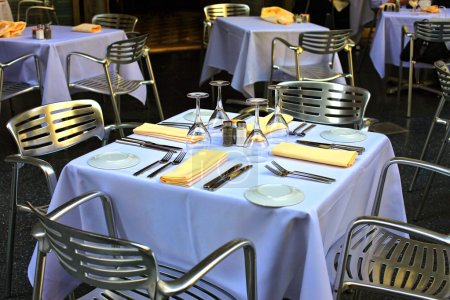 Photo for Empty set of glass and plates at restaurant - Royalty Free Image