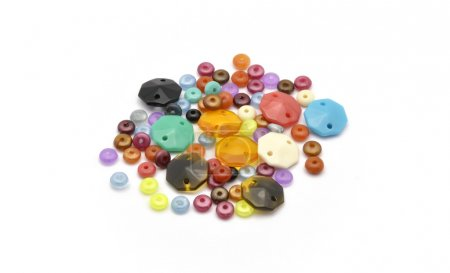 Colorful beads on white background