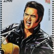 Постер, плакат: SENEGAL CIRCA 1998: A stamp printed in Senegal shows the famous Elvis Presley circa 1998