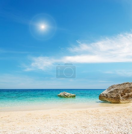 pebbles, water and sun