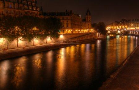 Paris at night: river Seine and illuminated riverbank at Ile de la Cite.