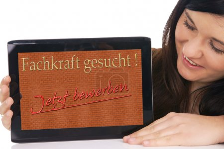 Woman with tablet pc and the german words Speciali...