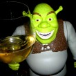 Shrek who toasts with a glass of wine...
