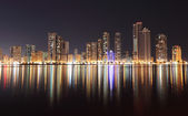 Skyline of Sharjah City at night, United Arab Emirates