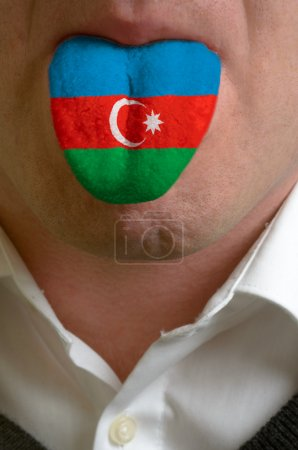 Man tongue painted in azerbaijan flag symbolizing to knowledge t