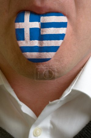 Man tongue painted in greece flag symbolizing to knowledge to sp
